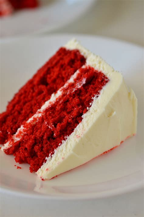 Deep Red Color red velvet cake with cream cheese frosting life in the