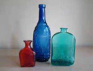 antique colored glass collection of 3 vintage colored glass bottles