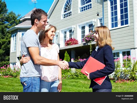 happy family realtor near new image photo bigstock