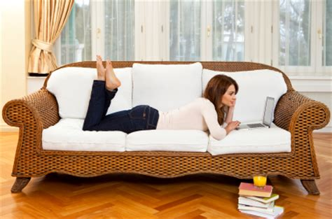 laptop on couch 10 worst work from home stock photos flexjobs