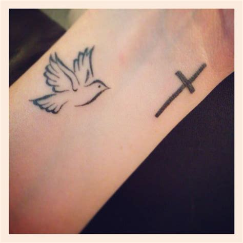 cross with bird tattoo 25 best ideas about dove design on