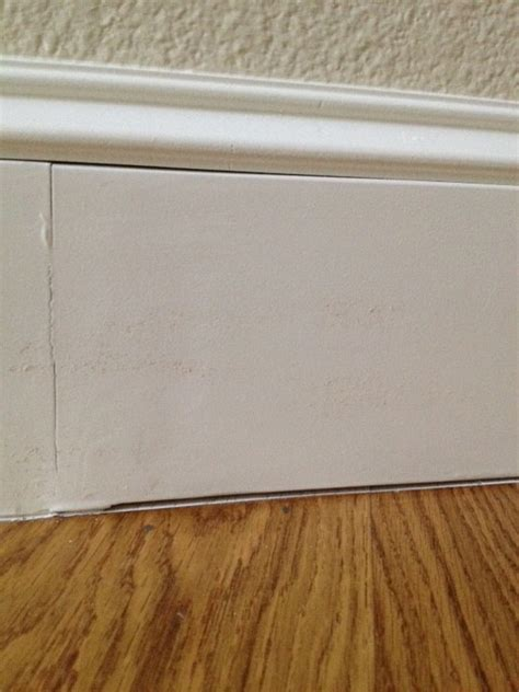how to fill gap between cabinet and floor caulking between baseboards and hardwood