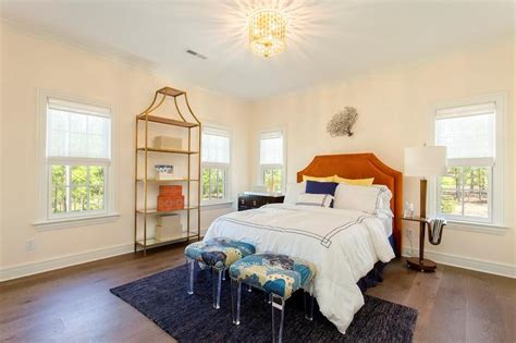 orange and gold bedroom teen bedroom with orange headboard and gold etagere