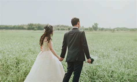 Wedding Holding by In White Wedding Dress Holding To In Black