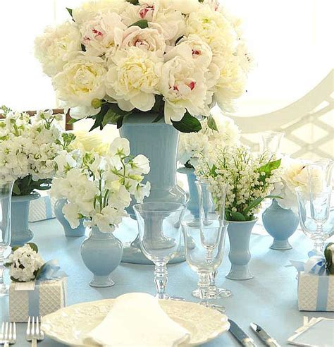 white centerpiece blue and white the sweetest occasion