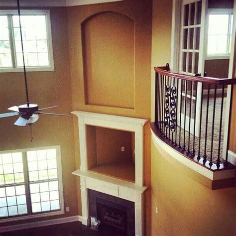 indoor balcony overlooking  living room home sweet