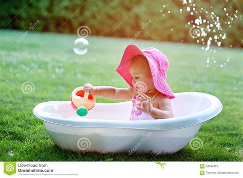 bubble soap for bathtub little girl sitting in a bathtub with soap bubbles stock