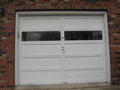 two 9 ft x 7 ft wooden overhead garage doors current price 70