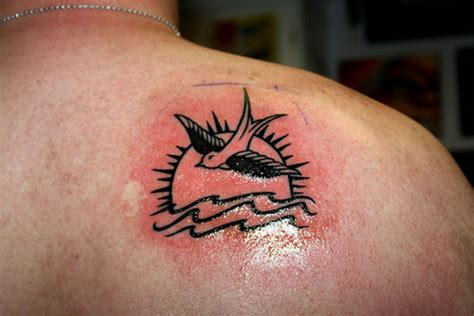 jack sparrow wrist tattoo 35 spectacular sparrow tattoos creativefan