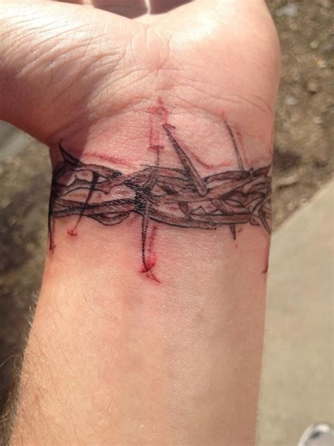 cross tattoo with crown of thorns crown of thorns bracelet tattoos the o