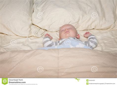 sleeping with baby in bed baby sleeping in bed royalty free stock photography
