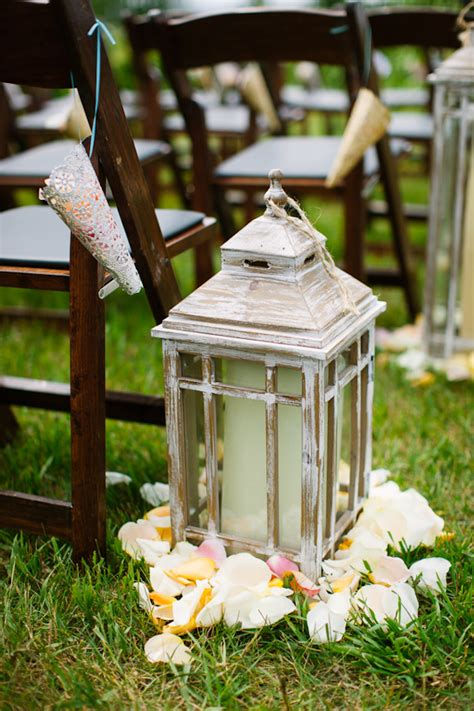 Wedding Aisle Decorations With Lanterns by Vintage Style Lanterns With Candles And Flower Petals As