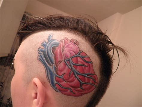 human heart tattoo human on