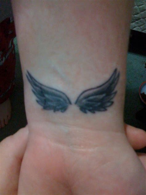 angel wing tattoo on wrist 28 wings tattoos on wrists