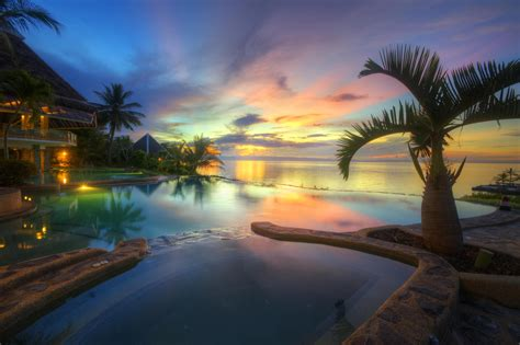 beach sea palm trees swimming pool philippines clouds
