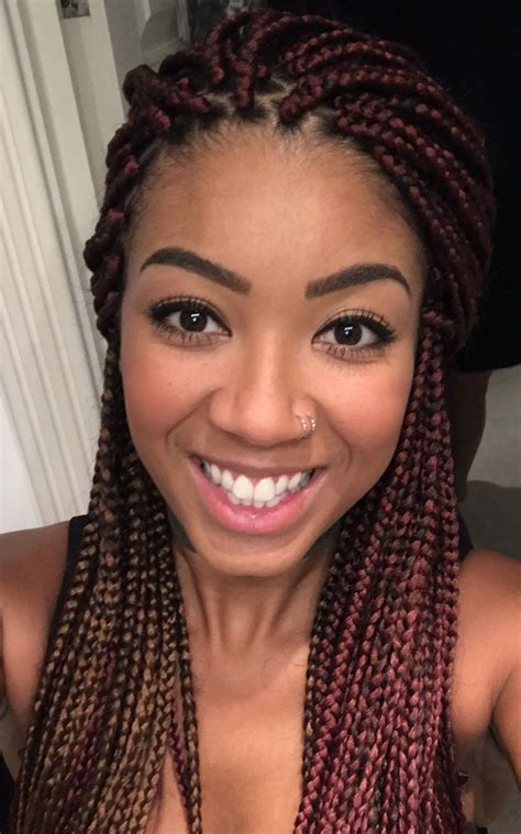 red medium small box braids with a hint of gold nvr
