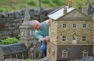 miniature homes models builder scales down his work and creates three miniature villages in his garden including a 12ft