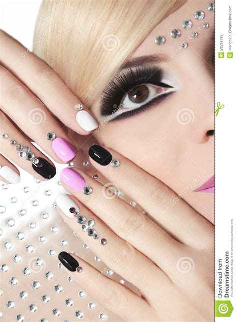 Fashion Nails by Fashion Nails And Makeup With Rhinestones Stock Image