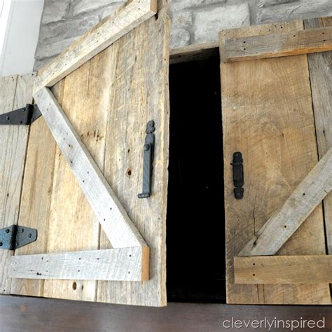 Kitchen Cabinet Closures by Barn Door Tv Cabinet Above Mantle Cleverly Inspired