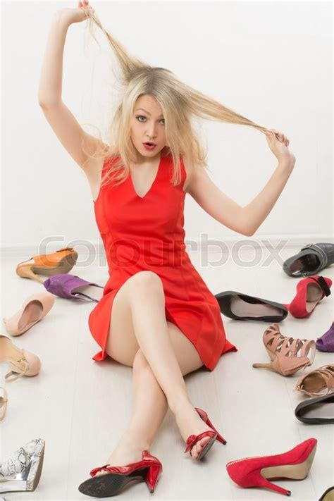 blonde bob red dress girl in red dress sitting on the floor selects shoes