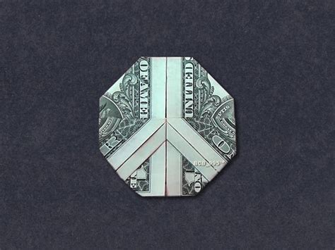 money origami peace sign dollar bill made with 1