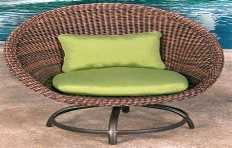 large artificial wicker outdoor chair green cushions
