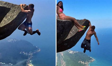hanging a picture hang 3000ft cliff in de janeiro