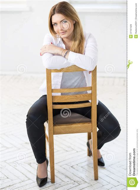 White Sitting Chair by In White Sit Backwards On Chair Stock Image Image