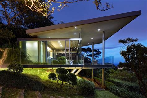 house music san jose glass house elevated on top of metallic columns has also 3 big glass sides that create open view