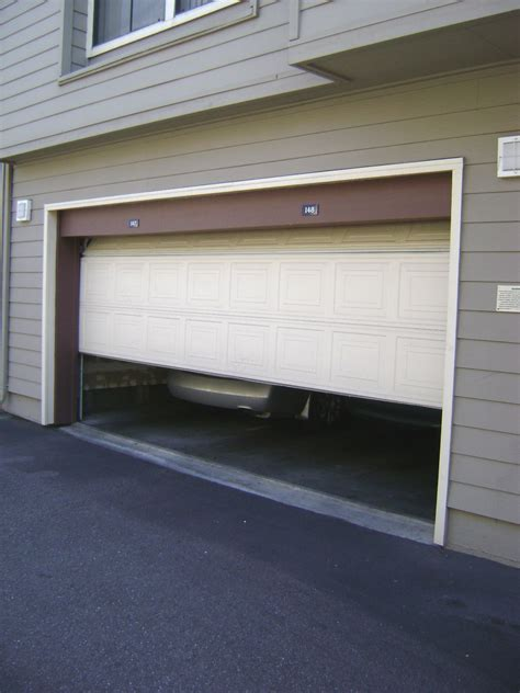 how to replace garage door torsion diy garage door repair doors