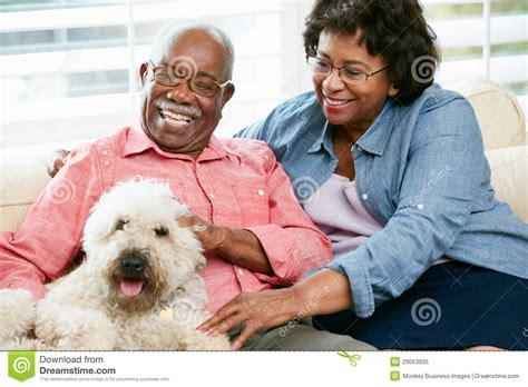 Happy Senior Sitting On Sofa With Royalty Free