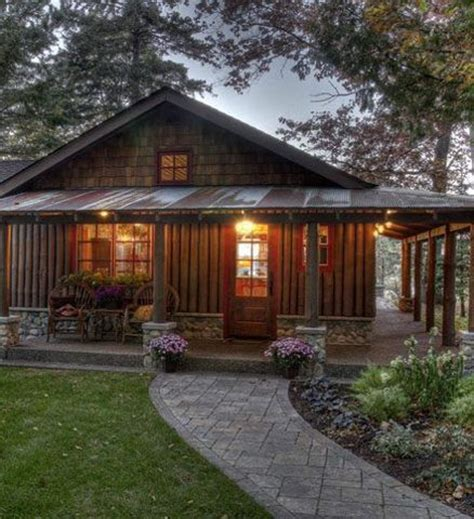 log cabin with wrap around porch exterior home designs wrap around porch with corrugated metal roof that s