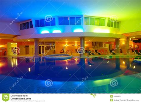 night view of roman style swimming pool with deck jets indoor hotel swimming pool by night editorial photo