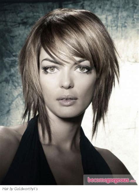 whispy easy layered haircuts for medium layered haircut wispy bangs light inward curl brown