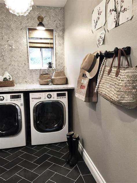 Greige Design Laundry Room   laundry room with marble herringbone backsplash tiles