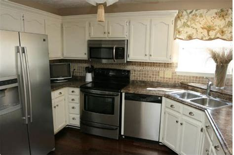 cheap kitchen makeover ideas before and after this reader submitted kitchen makeover is truly stunning