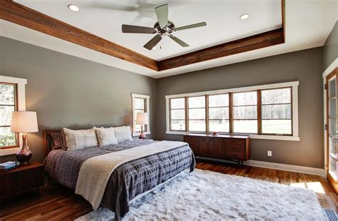 Light gray walls with wood trim family room transitional