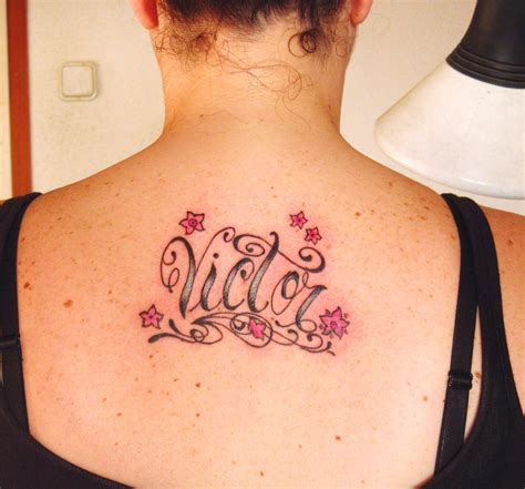 tattoo lettering upper back lovely lettering tattoo on upper back for girls