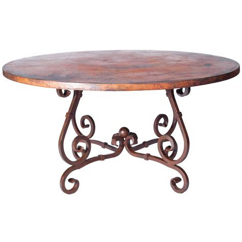 hammered copper dining table pictured here is the dining table with wrought iron