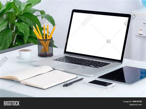 on desk laptop mockup with tablet computer smartphone and notebook