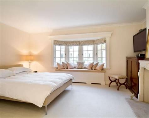 bay window seat bed photo of neutral beige white wood bedroom with bay
