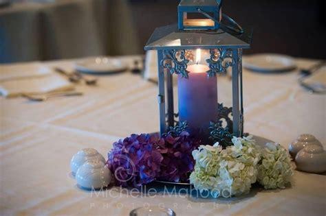silver lanterns for wedding centerpieces silver lantern centerpiece with hydrangea accents my event portfolio silver