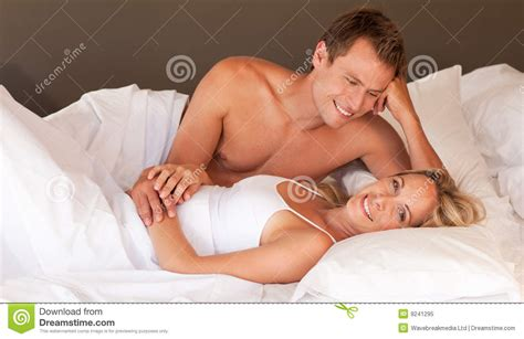 best beds for sex romantic couple lying on a bed stock image image of face