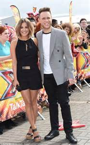 X Factor co hosts Caroline Flack and Olly Murs get to work