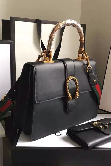 Jual Tas Gucci Duonysus Grained Top Handle Black Mirror Quality gucci dionysus leather top handle bag is a structured bag yet not thanks to its