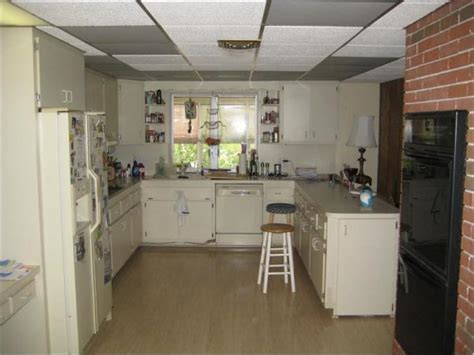 Drop ceiling in kitchen Replace it or update it