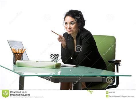 pretty businesswoman sitting at desk royalty