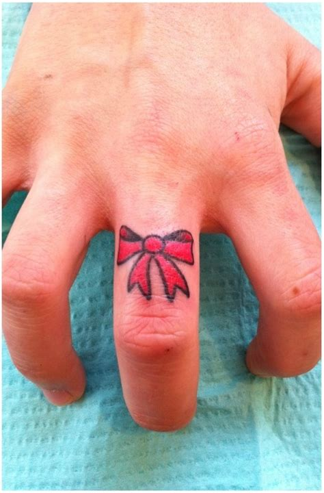tattoo on finger meaning bow tattoos designs ideas and meaning tattoos for you