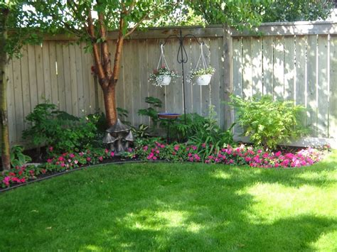 backyard fence landscaping ideas even though our yard is small we have planted many trees