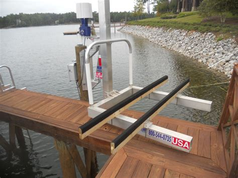 boat dock brands researching quot swing quot style pile mount small boat lifts